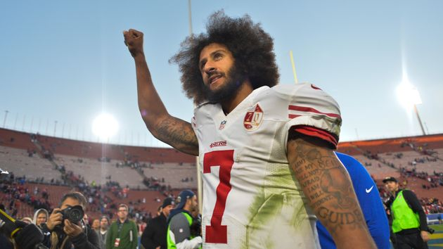 San Francisco 49ers quarterback Colin Kaepernick (7) pumps his fist as he acknowledges the cheers from...