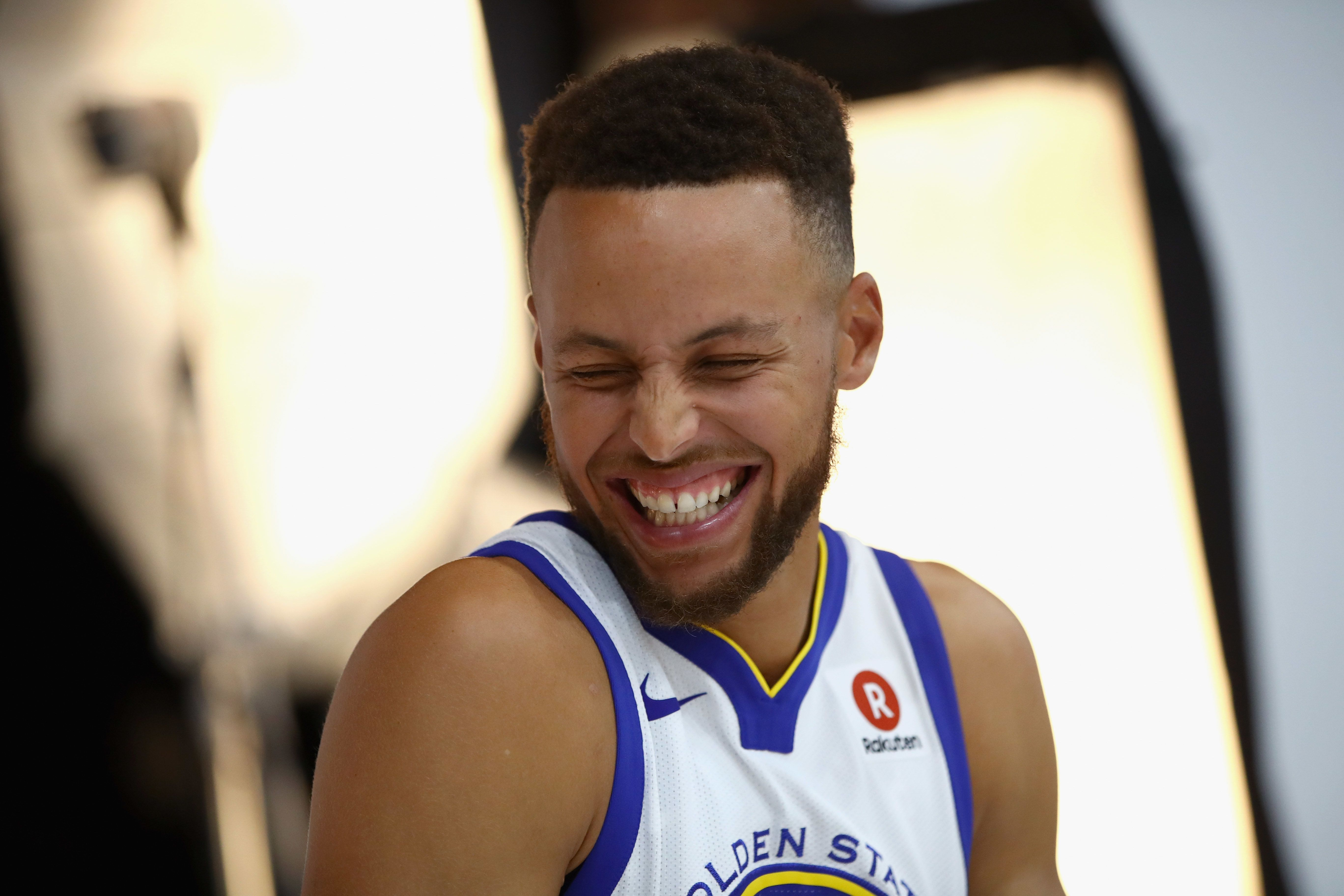 OAKLAND, CA - SEPTEMBER 22:  Stephen Curry #30 of the Golden State Warriors laughs during a photo shoot during the Golden States Warriors media day at Rakuten Performance Center on September 22, 2017 in Oakland, California. NOTE TO USER: User expressly acknowledges and agrees that, by downloading and or using this photograph, User is consenting to the terms and conditions of the Getty Images License Agreement.  (Photo by Ezra Shaw/Getty Images)