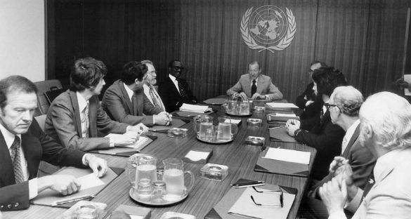 <p>Meeting at the UN on UFOs. Clockwise from left: astronaut Gordon Cooper, astronomer Jacques Vallee, astronomer/astrophysicist Claude Poher, astronomer J. Allen Hynek, Grenada Prime Minister Sir Eric Gairy, UN Secretary-General Kurt Waldheim, Morton Gleisner of the Special Political Committee, Lee Speigel, researcher Len Stringfield, and University of Colorado psychologist David Saunders.</p>