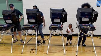 LAS VEGAS, NV - NOVEMBER 08:  Voters cast their ballots at voting machines at Shadow Ridge High School on Election Day on November 8, 2016 in Las Vegas, Nevada. Americans across the nation are picking their choice for the next president of the United States.  (Photo by Ethan Miller/Getty Images)