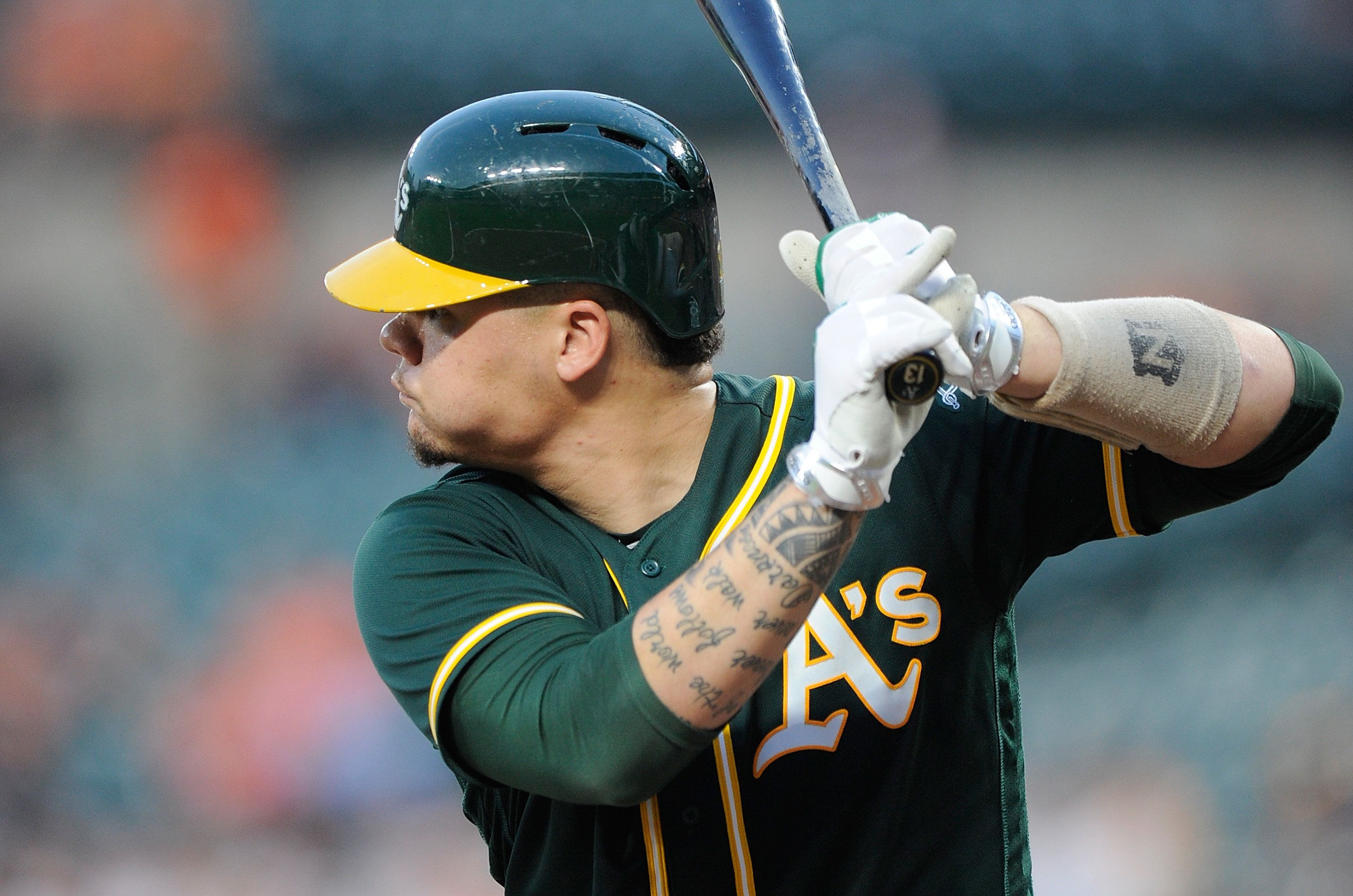 BALTIMORE, MD - AUGUST 22:  Bruce Maxwell #13 of the Oakland Athletics bats against the Baltimore Orioles at Oriole Park at Camden Yards on August 22, 2017 in Baltimore, Maryland.  (Photo by G Fiume/Getty Images)