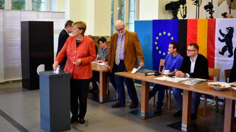 BERLIN, GERMANY - SEPTEMBER 24: German Chancellor and Christian Democrat (CDU) Angela Merkel casts her ballot in German federal elections on September 24, 2017 in Berlin, Germany. Merkel is seeking a fourth term and has a strong lead going into the elections over her rivals. However a significant number of voters were undecided in days prior to the election and the full outcome remains difficult to predict. (Photo by Alexander Koerner/Getty Images)