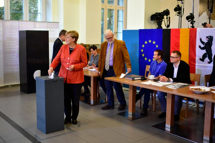 German Chancellor and Christian Democrat (CDU) Angela Merkel casts her ballot in German federal elections on September 24.