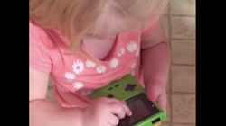 Little Girl Attempts To Play With Game Boy, Flabbergasted By Lack Of