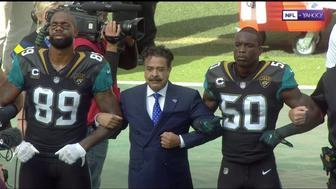 Jaguars owner Shad Khan locked arms with players in London on Sunday amid protests