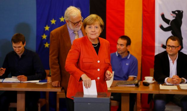 German Chancellor and leader of the Christian Democratic Union CDU Angela Merkel votes in the general election...