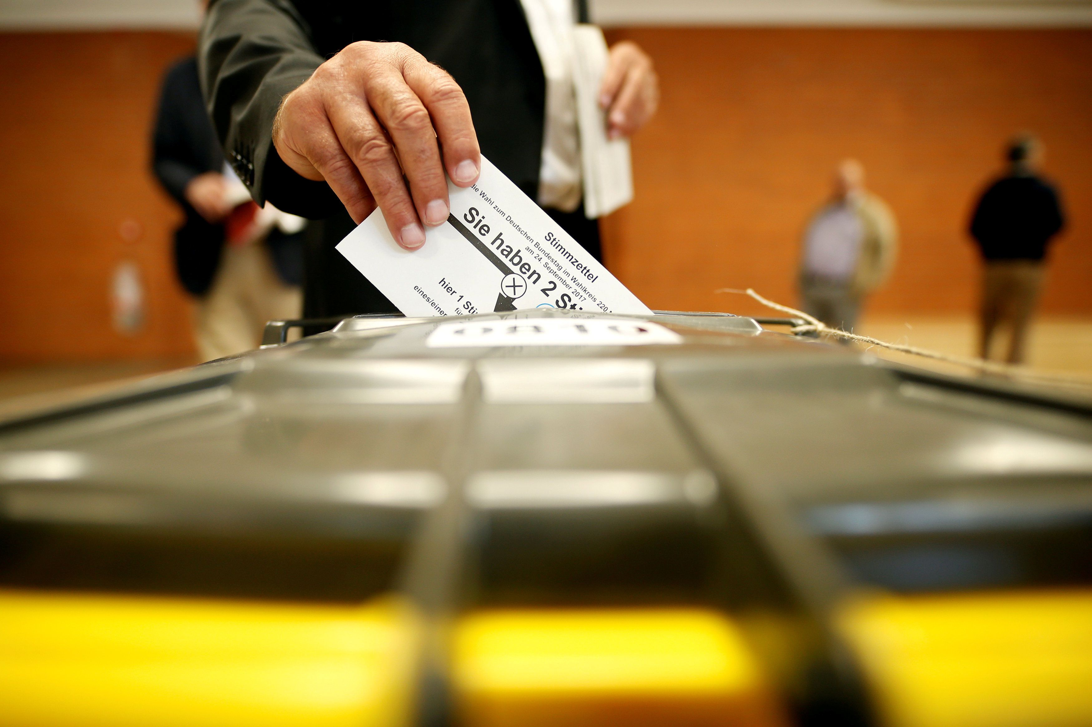 Michaela Rehle  Reuters People vote in the general election in Munich Germany