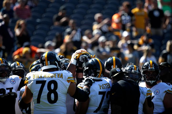 The Pittsburgh Steelers huddle up during warm-ups prior to the game against the Chicago Bears at Soldier Field on Sept. 24, 2