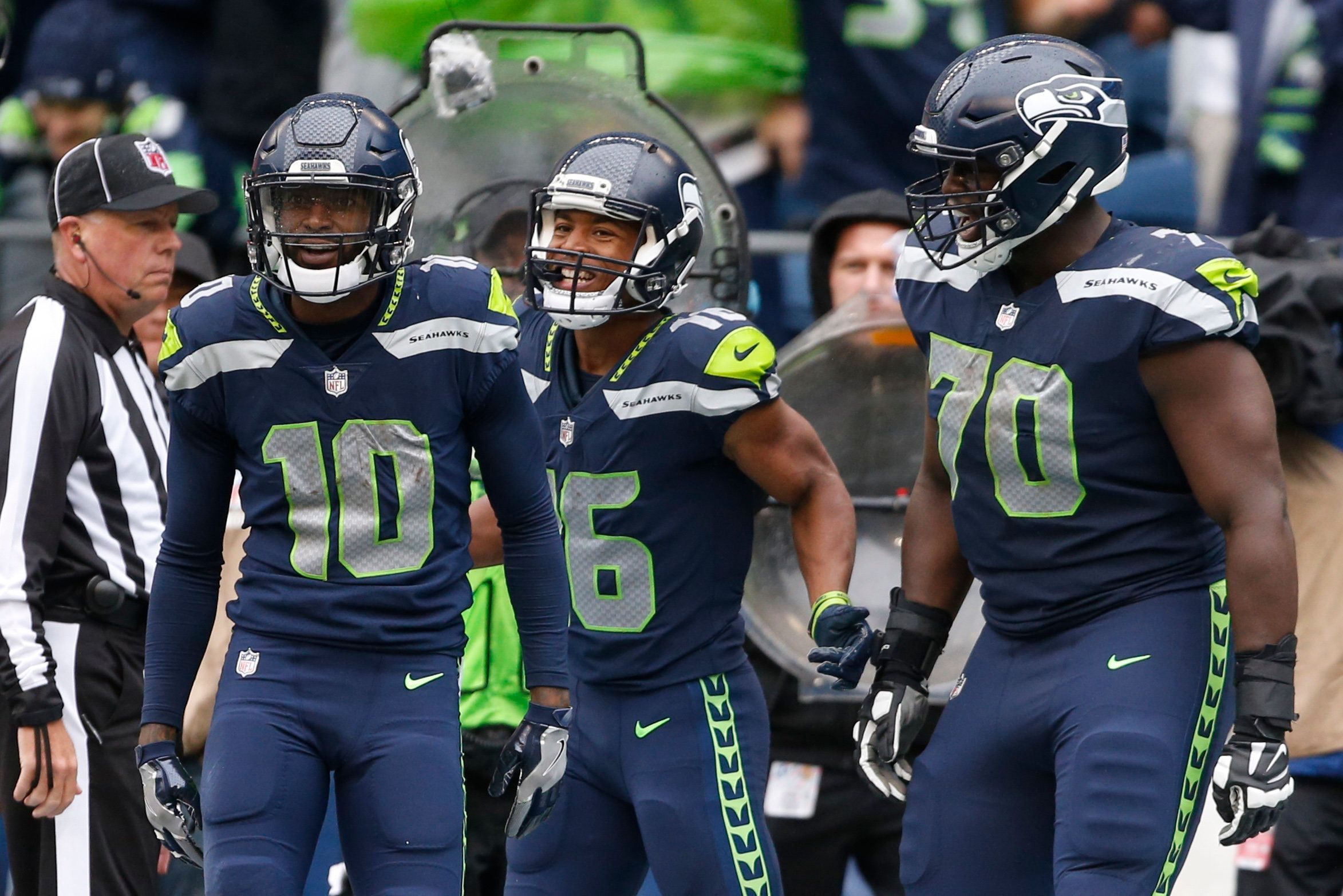 Sep 17, 2017; Seattle, WA, USA; Seattle Seahawks wide receiver Tyler Lockett (16) celebrates with wide receiver Paul Richardson (10) and offensive tackle Rees Odhiambo (70) after catching a touchdown pass against the San Francisco 49ers during the fourth quarter at CenturyLink Field. Mandatory Credit: Joe Nicholson-USA TODAY Sports