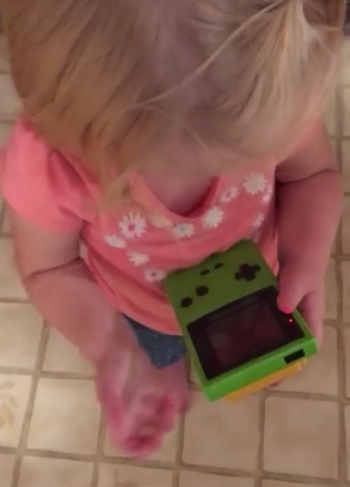 Want To Feel Old? Watch This Girl Try To Use A Game