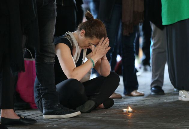 Candles are lit by people attending a vigil held at the Maxilla Social Club, west London, to mark one...