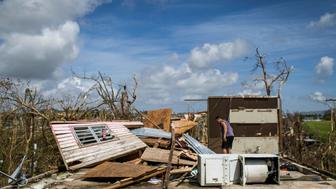 JUNCOS PUERTO RICO  SEPTEMBER 24: Juan Ramon Velazquez cleans up debris on the second floor of his residence. The mountain town of Juncos is one of the most affected after the pass of Hurricane María. Hurricane Maria passed through Puerto Rico leaving behind a path of destruction across the national territory. (Photo by Dennis M. Rivera Pichardo for The Washington Post via Getty Images)