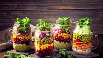 Homemade vegetable salad in a glass jar