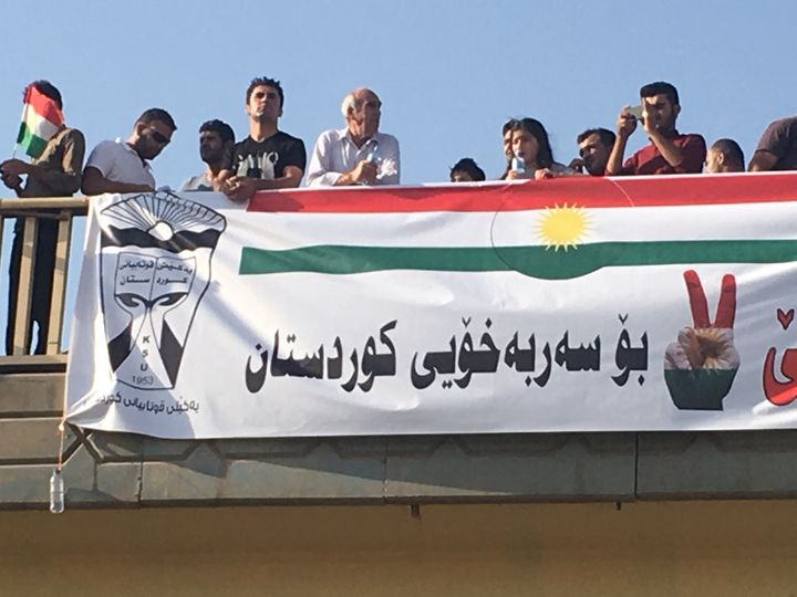 <em>Kurdish independence supporters look on from overpass, Erbil, Iraq, Sept. 22, 2017.</em>