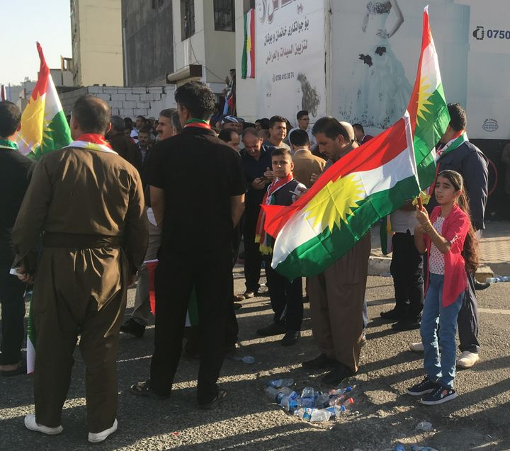 <em>  Kurds look on at rally for independence, Erbil, Iraq, Sept. 22, 2017.</em>