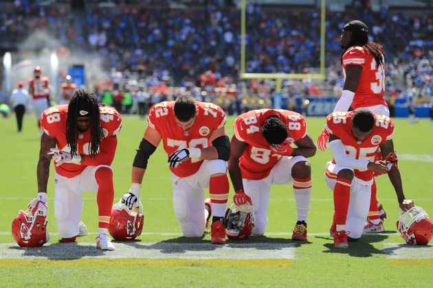 Players from the Kansas City Chiefs seen taking a knee before a game on Sept.