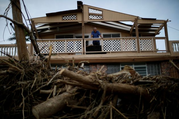 A man looks at the damages to his house after the area was hit by Hurricane Maria in Toa Baja, Puerto