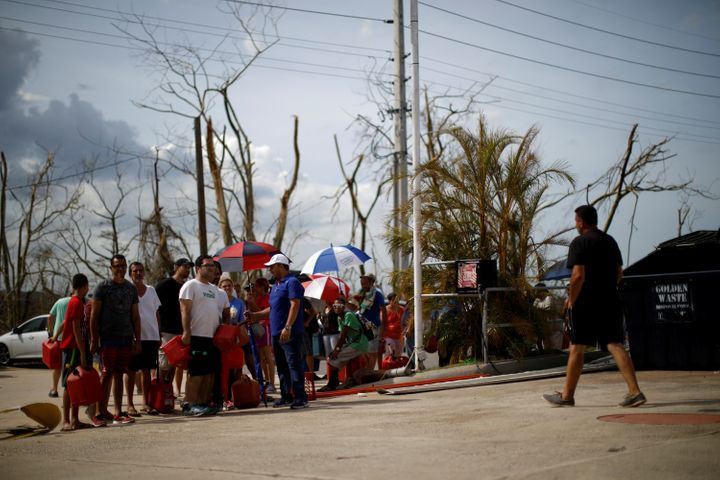 People queue to fill containers with gasoline at a gas station after the area was hit by Hurricane Maria in Toa Baja, Pu