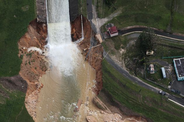 An aerial view shows the damage Saturday to the Guajataca dam in the aftermath of Hurricane Maria, in...