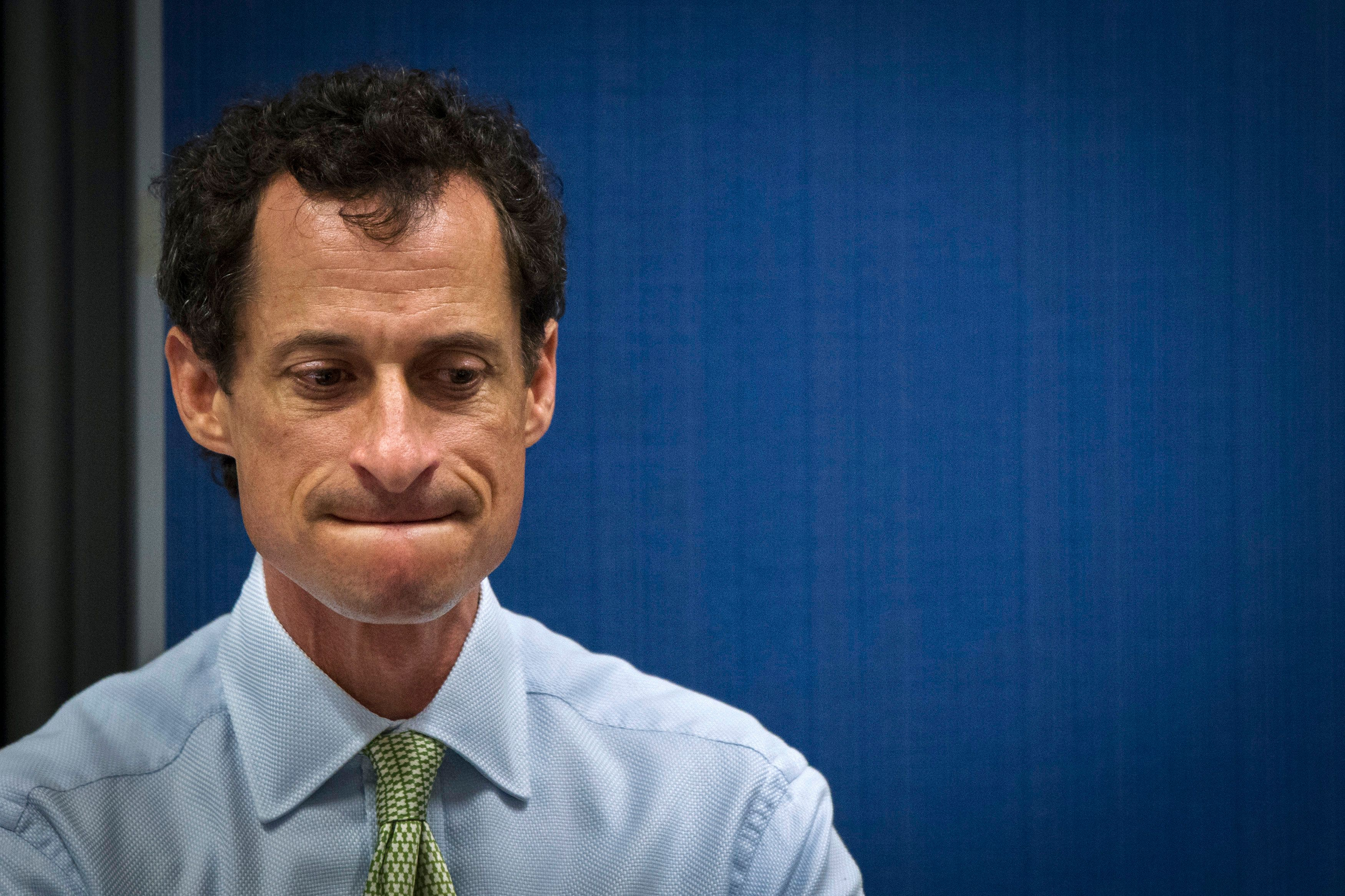 Former U.S. congressman from New York and current democratic candidate for New York City Mayor Anthony Weiner listens to fellow candidates speak at a debate held at the Museum of Tolerance in New York August 14, 2013.  REUTERS/Lucas Jackson (UNITED STATES - Tags: POLITICS)