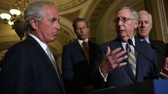WASHINGTON, DC - SEPTEMBER 09:  U.S. Senate Majority Leader Sen. Mitch McConnell (R-KY) (3rd L) speaks to members of the media as (L-R) Sen. Bob Corker (R-TN), Sen. John Thune (R-SD), and Senate Majority Whip Sen. John Cornyn (R-TX) listen after the weekly Senate Republican Policy Luncheon at the Capitol September 9, 2015 in Washington, DC. Sen. Corker and the Republican leadership discussed the Iran nuclear agreement.  (Photo by Alex Wong/Getty Images)