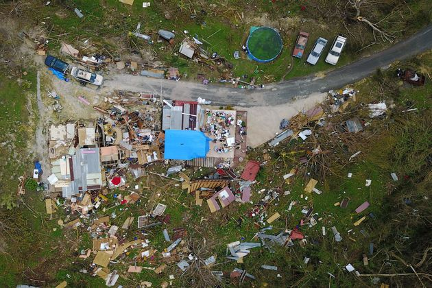 A house destroyed by hurricane winds is seen in Corozal, west of San Juan, Puerto Rico, on Sept. 24...