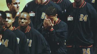 CHICAGO, IL - MARCH 15:  Denver Nuggets guard Mahmoud Abdul-Rauf (C) bows his head in prayer 15 March in Chicago, Illinois, during the singing of the national anthem before playing the Chicago Bulls. Abdul-Rauf was suspended for one-game after refusing to stand for the national anthem earlier in the week, but reached a compromise with the National Basketball Association. AFP PHOTO Eric CHU  (Photo credit should read ERIC CHU/AFP/Getty Images)