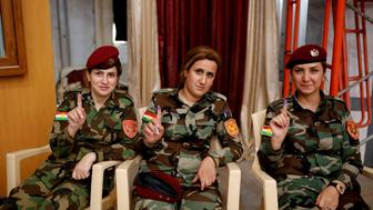 ERBIL, IRAQ - SEPTEMBER 25 : Peshmerga forces cast their ballots in the Kurdish Regional Government (KRG) controversial referendum at a military polling station in Rashkin village of Erbil, Iraq on September 25, 2017. The non-binding referendum is taking place in areas under the control of the Kurdish Regional Government (KRG) in northern Iraq. According to data released by the KRG Independent High Electoral Commission, over 5 million people are expected to vote in the referendum. (Photo by Yunus Keles/Anadolu Agency/Getty Images)