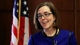 Oregon Governor Kate Brown speaks at the state capital building in Salem, Oregon, February 20, 2015. Brown, a liberal Democrat from Portland, outlined her policy agenda on Friday in her first media event since she took the helm of the Pacific Northwest state to replace John Kitzhaber, whose decades-long political career dissolved in the wake of an influence-peddling scandal involving his fiancee.  REUTERS/Steve Dipaola (UNITED STATES - Tags: POLITICS HEADSHOT)