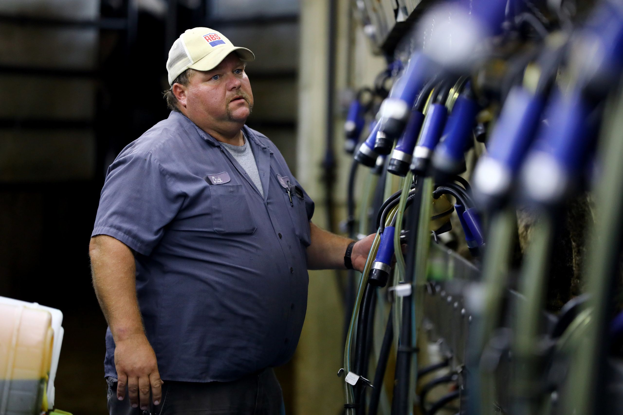 Chuck Ripp troubleshoots a machine in the milking parlor at his farm, Ripp's Dairy Valley, in Dane, Wisconsin, Sept. 12, 2017
