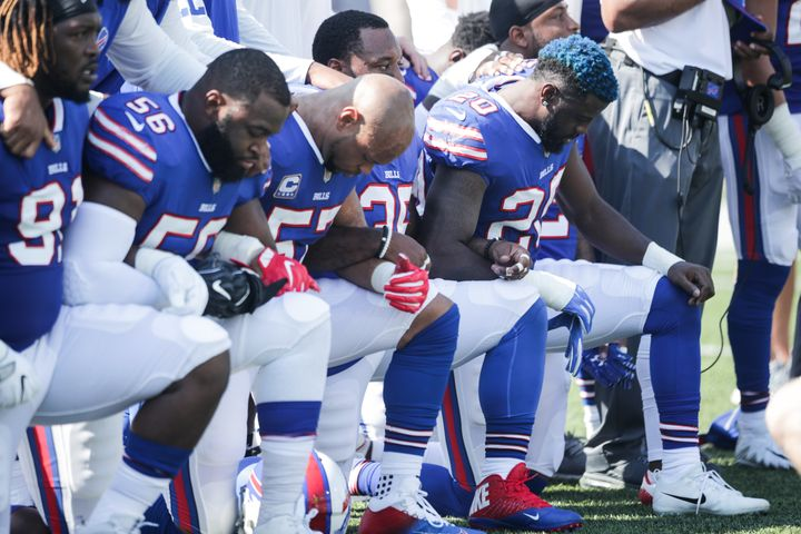 Buffalo Bills players knelt during the national anthem before their game against the Denver Broncos on Sunday, Sept. 24.&nbsp