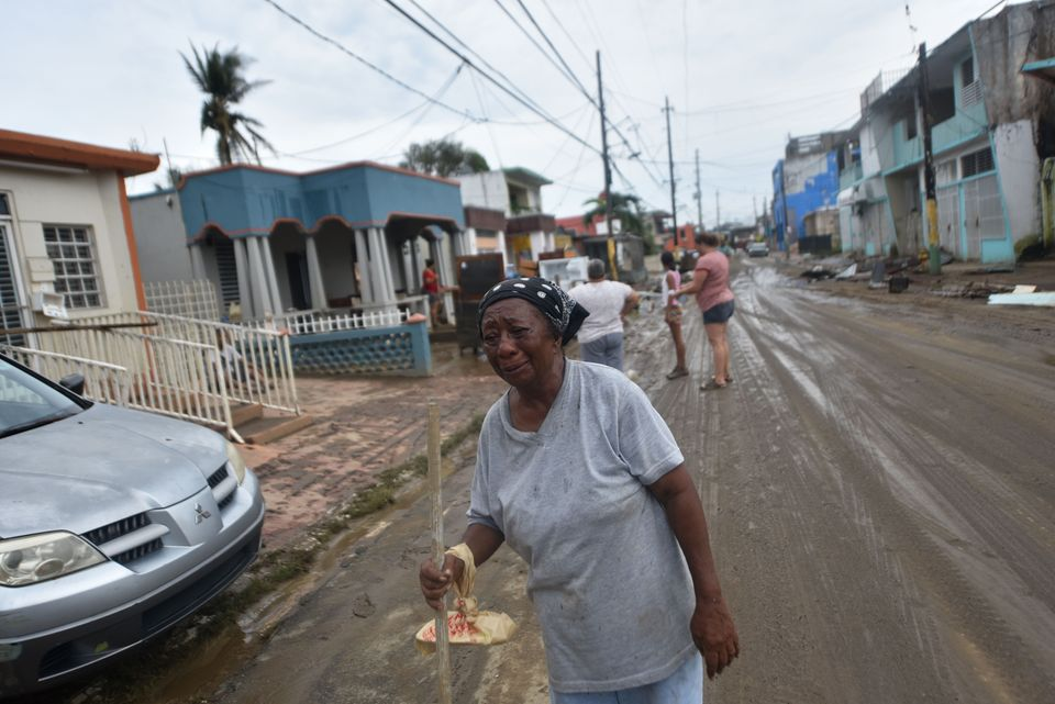 Maria Lopez cries while walking from her house that was flooded after the passage of Hurricane Maria, in Toa Baja, Puerto Ric