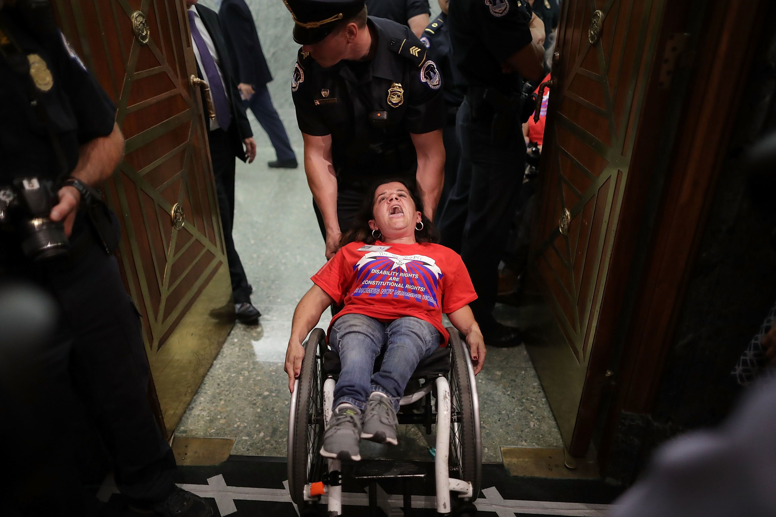 U.S. Capitol Police arrest activists from handicap advocacy organizations as protest during a Senate Finance Commit