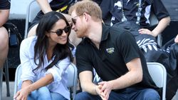 The First Public Photos Of Prince Harry And Meghan Markle Holding