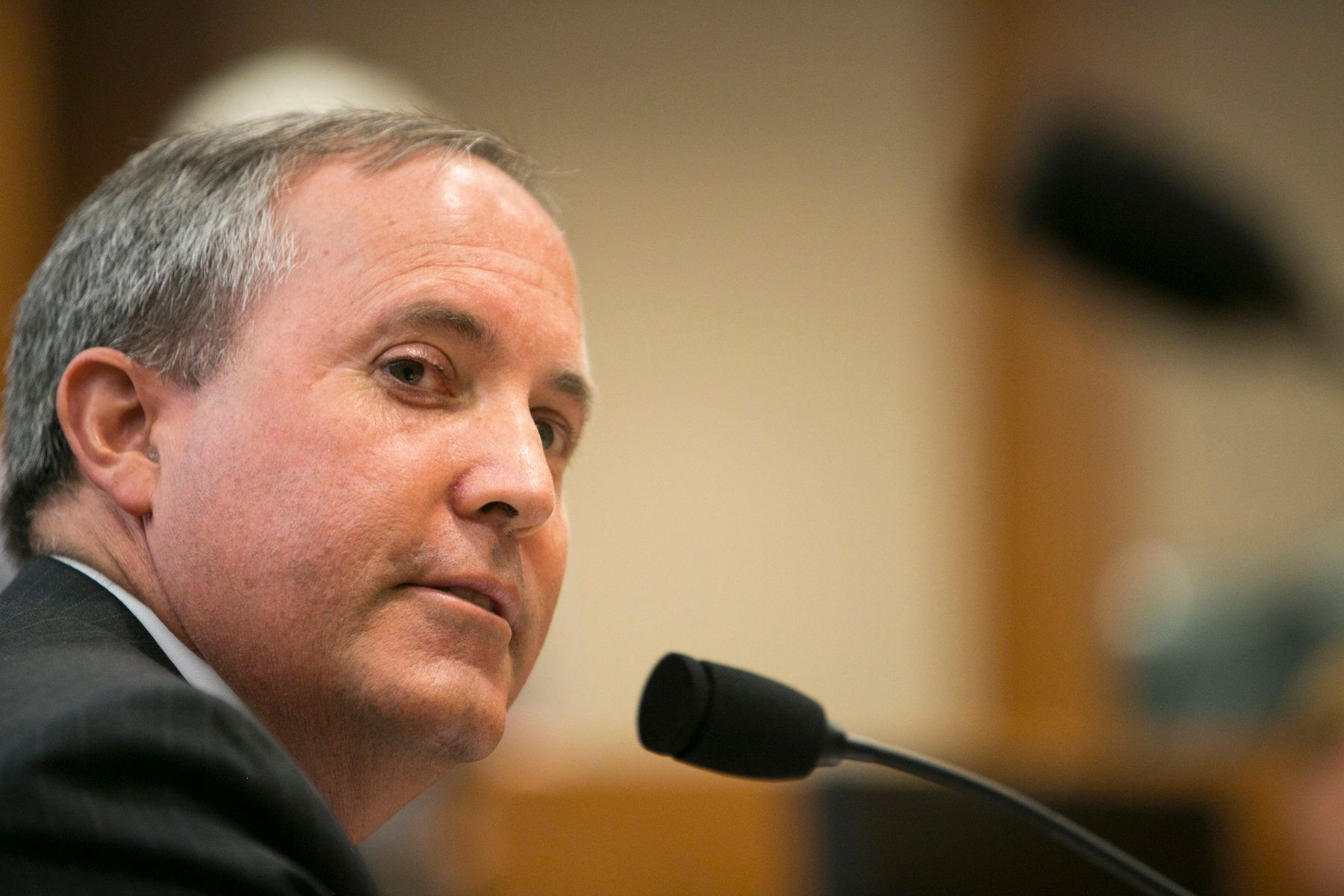 Texas Attorney General Ken Paxton celebrated Monday's ruling that partially lifts an injunction to keep a state immigration c