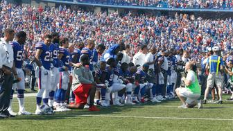 Sep 24, 2017; Orchard Park, NY, USA; Buffalo Bills players kneel in protest during the National Anthem before a game against the Denver Broncos at New Era Field. Mandatory Credit: Timothy T. Ludwig-USA TODAY Sports