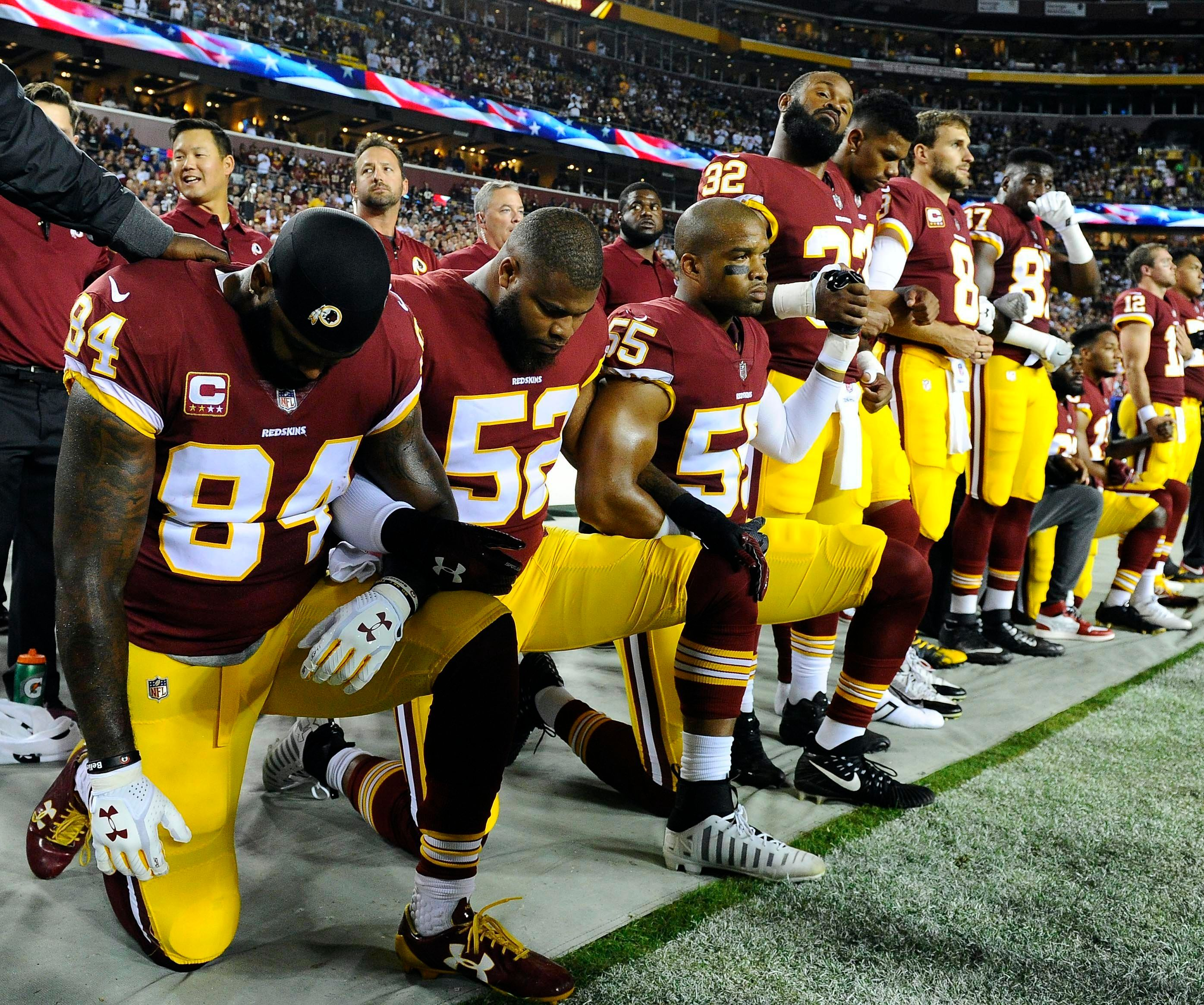 Sep 24, 2017; Landover, MD, USA; Washington Redskins tight end Niles Paul (84) and linebacker Ryan Anderson (52) and Washington Redskins linebacker Chris Carter (55) kneel with teammates during the playing of the national anthem before the game between the Washington Redskins and the Oakland Raiders at FedEx Field. Mandatory Credit: Brad Mills-USA TODAY Sports     TPX IMAGES OF THE DAY