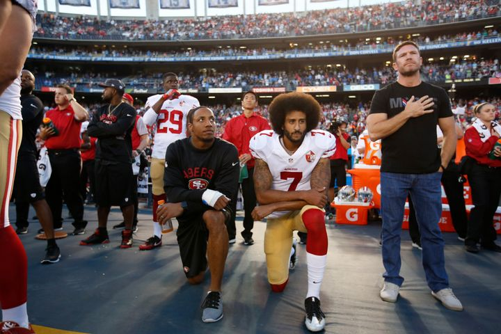 Then-teammates Colin Kaepernick (center) and Eric Reid knelt during the national anthem on Sept. 1, 2016. Former Green Beret