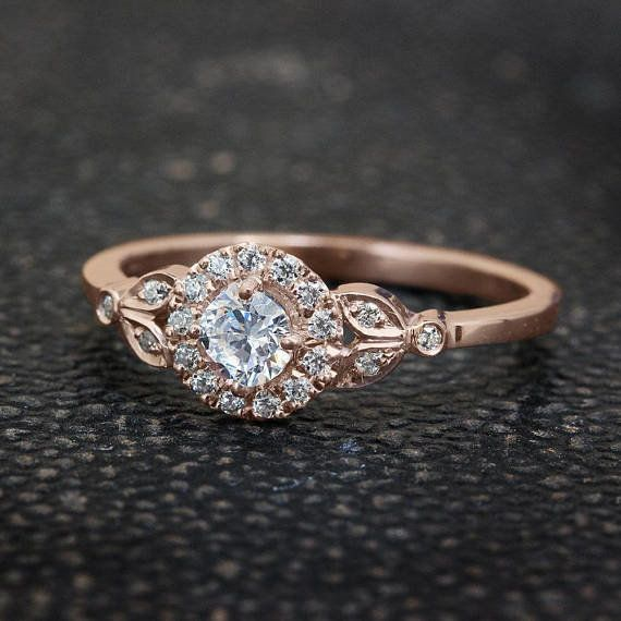 "<i>Buy it from <a href=""https://www.etsy.com/listing/201594006/leaf-engagement-ring-18k-rose-gold-ring?ga_search_query=v"