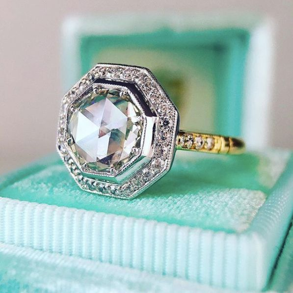 "<i>Buy it from <a href=""https://trabertgoldsmiths.com/products/1-10ct-savannah-rose-cut-diamond-hexagonal-ring"" target=""_blan"