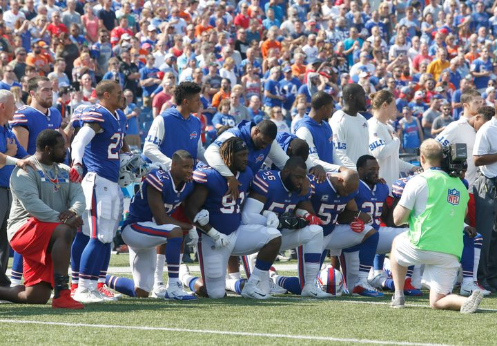 Buffalo Bills players kneel in protest during the national anthem before a game in New York against the Denver Broncos on Sun