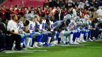 Sep 25, 2017; Glendale, AZ, USA; The Dallas Cowboys players, coaches and staff take a knee prior to the National Anthem before the game against the Arizona Cardinals at University of Phoenix Stadium. Mandatory Credit: Matt Kartozian-USA TODAY Sports