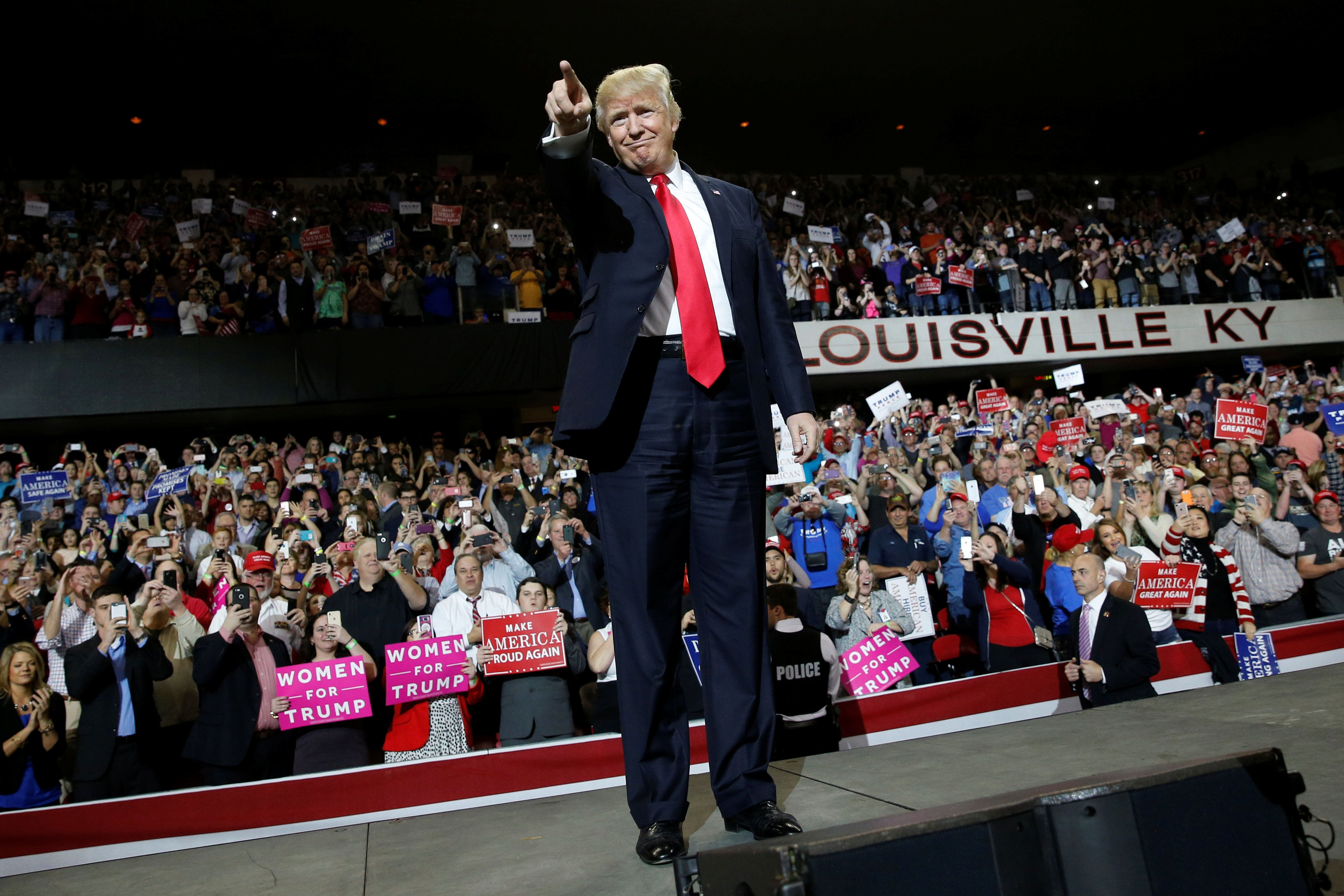U.S. President Donald Trump takes the stage for a rally at the Kentucky Exposition Center in Louisville, Kentucky, U.S. March 20, 2017. REUTERS/Jonathan Ernst