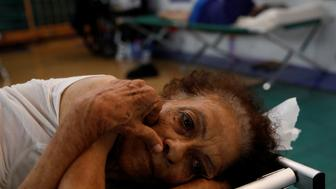 Hilda Colon wakes up after sleeping in a shelter set up at the Pedrin Zorrilla coliseum after the area was hit by Hurricane Maria in San Juan, Puerto Rico, September 25, 2017. REUTERS/Carlos Garcia Rawlins