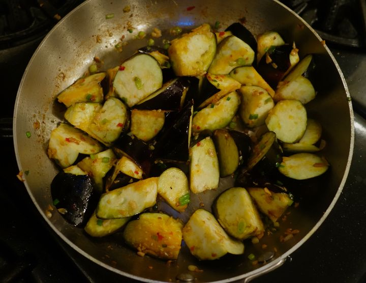 Cook the eggplant with the remaining aromatics (including Chinese chili sauce from a jar) until tender