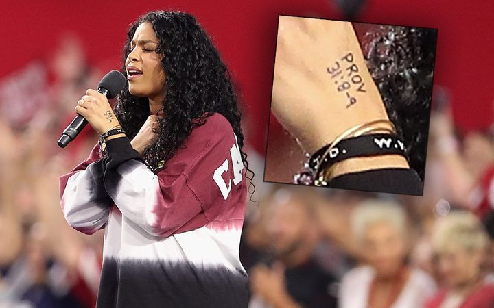 Singer Jordin Sparks performs the National Anthem before the start of the the NFL game between the Arizona Cardinals and the