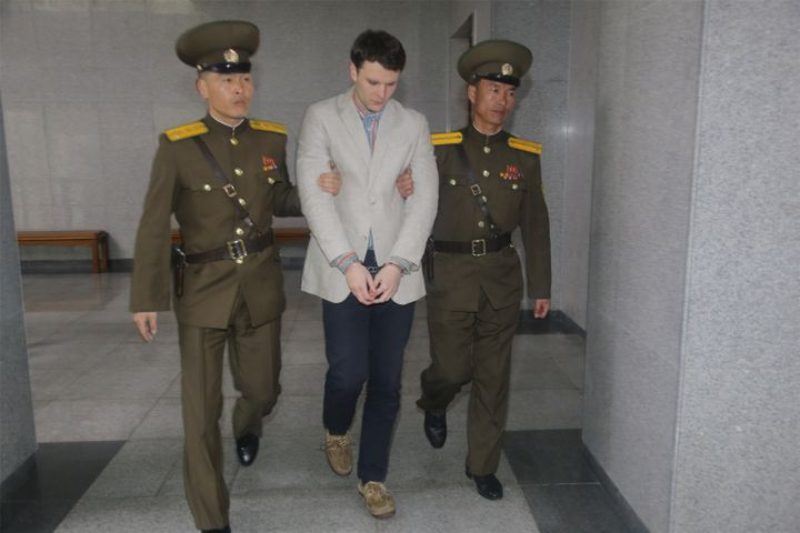 American student Otto Frederick Warmbier arrives at a court for his trial in Pyongyang, capital of the Democratic People's Re