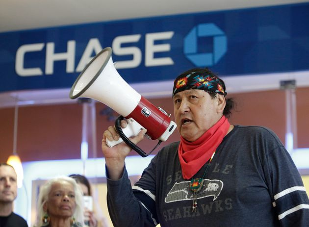 Raymond Kingfisher speaks as indigenous leaders and climate activists disrupt business on May 8 at a...