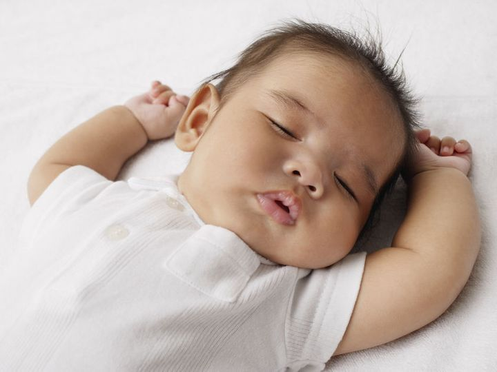 <p>Sleeping baby on their back </p>