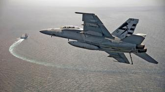A U.S. Navy F/A-18F Super Hornet jet piloted by LCDR Jamie R. Struck approaches the USS Gerald R. Ford to make the first landing using the AAG arrested landing system in the Atlantic Ocean July 28, 2017. The carrier was also testing the EMALS electromagnetic launch system, which replaces the steam-piston catapult. Picture taken July 28, 2017. U.S. Navy/Erik Hildebrandt/Handout via REUTERS ATTENTION EDITORS - THIS IMAGE WAS PROVIDED BY A THIRD PARTY?